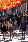 Face masks as Lisle Street in Chinatown remains very quiet with a few people visiting Chinese restaurants to pick up food and to see the red lanterns on 25th June 2020 in London, England, United Kingdom. As the July deadline approaces and government will relax its lockdown rules further, the West End remains quiet, while some non-essential shops are allowed to open with individual shops setting up social distancing systems.