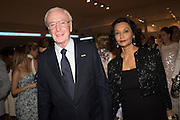 SIR MICHAEL CAINE; LADY SHAKIRA CAINE, The Neo Romantic Art Gala in aid of the NSPCC. Masterpiece. Chelsea. London.  30 June 2015