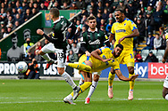 Stuart O'Keefe (13) of Plymouth Argyle intercepts the ball before Jake Jervis (10) of AFC Wimbledon can shoot at goal during the EFL Sky Bet League 1 match between Plymouth Argyle and AFC Wimbledon at Home Park, Plymouth, England on 6 October 2018.