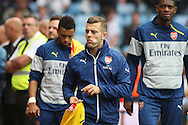 Jack Wilshere of Arsenal with his tongue in his cheek makes his way to the bench before kick-off. Barclays Premier league match, Aston Villa v Arsenal at Villa Park in Birmingham on Saturday 20th Sept 2014<br /> pic by Mark Hawkins, Andrew Orchard sports photography.