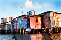 Palafitas or Stilt dwellers living and fishing on the river that flows through Recife in Northeastern Brazil.