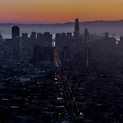 San Francisco sunrise view from Twin Peaks near Sunset District looking eastward toward the Bay and Oakland/Alameda.