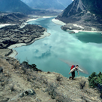 Trekker above Tsangpo River (Brahmaputra), near start of deep Himalayan gorge.