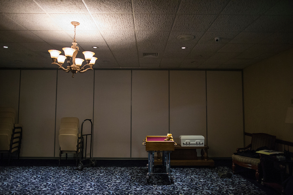 """A casket containing the remains of an abandoned newborn baby is seen in a chapel at Glueckert Funeral Home in preparation for funeral and burial services in Arlington Heights, Illinois, United States, June 19, 2015. More than a year after he was found dead in a plastic shopping bag on a Chicago sidewalk, the baby boy was buried by a non-profit group """"Rest in His Arms"""" after being abandoned by his teenage mother, who is charged with murder. REUTERS/Jim Young"""