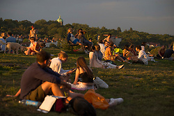 © Licensed to London News Pictures. 07/08/2020. London, UK. Members of public are seen enjoying the sunset at Hampstead Heath, north London; during one of the warmest day of the year, as temperatures reach 36 degrees Photo credit: Marcin Nowak/LNP
