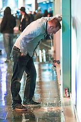 © Licensed to London News Pictures . 01/01/2017 . Manchester , UK . A man vomits on to the pavement on Withy Grove . People on a night out in Manchester City Centre , after midnight on January 1st 2017 . Photo credit : Joel Goodman/LNP
