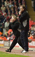 Photo. Jed Wee<br />Liverpool v Middlesbrough, FA Barclaycard Premiership, Anfield, Liverpool. 08/02/2003.<br />Puzzlement and frantic urgency grip Gerard Houllier's stand-ins for the day, Sammy Lee (L) and Phil Thompson, as the manager is too ill to take his place on the bench.