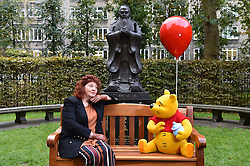 EDITORIAL USE ONLY<br /> Philosopher Dr Catherine McCall sits on a bench, known as a ÔThotful SpotÕ, that talks to you when you sit on it, next to the statue of Confucius at King's College, London, to celebrate the 90th anniversary of the publication of AA Milne's first collection of stories about Winnie-the-Pooh this Friday.