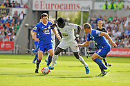 Bafetimbi Gomis of Swansea City makes a break  in the first half.<br /> Barclays Premier League match, Swansea city v Everton at the Liberty Stadium in Swansea, South Wales on Saturday 19th September 2015.<br /> pic by Phil Rees, Andrew Orchard sports photography.
