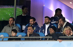 Lionel Messi and Sergio Aguero are seen in the stands during the international friendly match at the Eithad Stadium, Manchester.