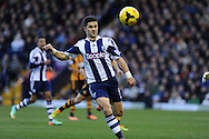 Shane Long of West Brom in action.Barclays Premier league, West Bromwich Albion v Hull city at the Hawthorns in West Bromwich, England on Saturday 21st Dec 2013. pic by Andrew Orchard, Andrew Orchard sports photography.