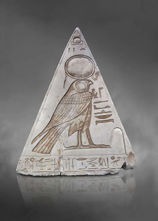 """South face of Ancient Egyptian Pyramidion of Ramose with depictionof Horus, Limestone, New Kingdom, 19th Dtnasty (1292-1190 BC), Dier el-Medina. Egyptian Museum, Turin. Old Fund cat 1603. Grey background.<br /> <br /> <br /> The South face of the Ramose Pyramidion shows Horus standing in a dipole magnetic field supporting the strong coronal electric field of the Sun. The hieroglyphs read:<br />  """"The Stellar dipole magnetic field is supported by many negative charges or electrons.""""<br /> The limestone Pyramidion of Ramose, from the top of the tomb of the 'Necropolis Scribe'. Scenes on all four sides depict the worship of the sun. .<br /> <br /> If you prefer to buy from our ALAMY PHOTO LIBRARY  Collection visit : https://www.alamy.com/portfolio/paul-williams-funkystock/ancient-egyptian-art-artefacts.html  . Type -   Turin   - into the LOWER SEARCH WITHIN GALLERY box. Refine search by adding background colour, subject etc<br /> <br /> Visit our ANCIENT WORLD PHOTO COLLECTIONS for more photos to download or buy as wall art prints https://funkystock.photoshelter.com/gallery-collection/Ancient-World-Art-Antiquities-Historic-Sites-Pictures-Images-of/C00006u26yqSkDOM"""