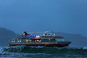 Passenger boat in stormy waves, Norway | Hurtigruten MS Finnmarken passerer Ulsteinvik og Flø i røff sjø.
