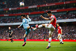Man City Midfielder David Silva (ESP) and Arsenal Midfielder Mikel Arteta (ESP) clash resulting in a yellow card for the Man City Player - Photo mandatory by-line: Rogan Thomson/JMP - 07966 386802 - 29/03/14 - SPORT - FOOTBALL - Emirates Stadium, London - Arsenal v Manchester City - Barclays Premier League.