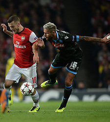LONDON, ENGLAND - Oct 01: Arsenal's midfielder Jack Wilshere from England  and Napoli's midfielder Valon Behrami from Switzerland during the UEFA Champions League match between Arsenal from England and Napoli from Italy played at The Emirates Stadium, on October 01, 2013 in London, England. (Photo by Mitchell Gunn/ESPA)