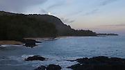 Full moon setting, dawn, Lumahai Beach,Kauai, Hawaii