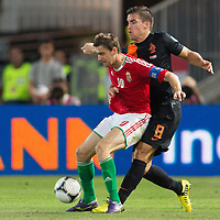 Hungary's Zoltan Gera (L) and Netherlands' Kevin Strootman (R) fights for the ball during a World Cup 2014 qualifying soccer match Hungary playing against Netherlands in Budapest, Hungary on September 11, 2012. ATTILA VOLGYI