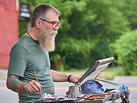 Todd Saal painting a street scene in Nolensville June 19, 2019.<br /> Photo: Harrison McClary/News & Observer