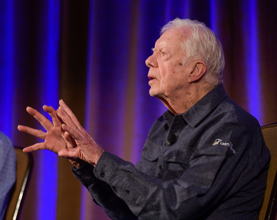 """Jimmy and Rosalynn Carter speak to a crowd of Carter Center donors at the annual """"Carter Center Weekend"""" retreat at Skamania Lodge in Washington State."""