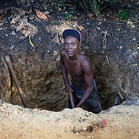 Digging a latrine as part of water and hygiene project run by ACT Alliance member SSID in the Dominican Republic.