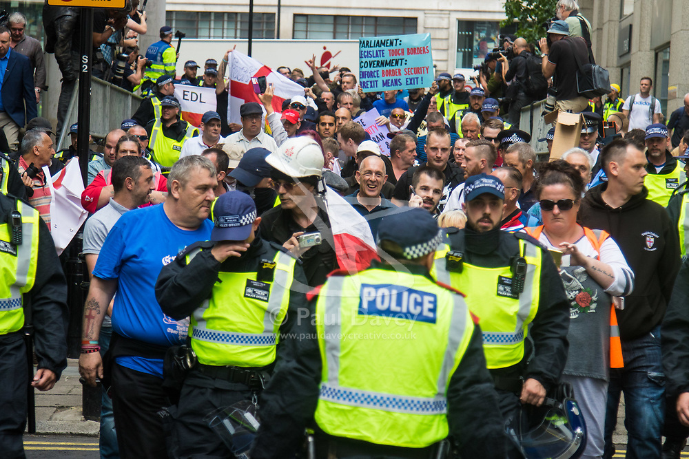 London, June 24th 2017. Anti-fascist protesters counter demonstrate against a march to Parliament by the far right anti-Islamist English Defence League. PICTURED: The EDL contingent numbering less than 100 marches towards their allocated position on Victoria Embankment.