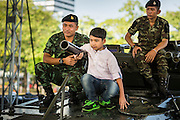 "11 JANUARY 2014 - BANGKOK, THAILAND:  A Thai boy and soldiers on top of a Scorpion armored reconnaissance vehicle during Children's Day in Bangkok. The Royal Thai Army hosted a ""Children's Day"" event at the 2nd Cavalry King's Guard Division base in Bangkok. Children had an opportunity to look at military weapons, climb around on tanks, artillery pieces and helicopters and look at battlefield medical facilities. The Children's Day fair comes amidst political strife and concerns of a coup in Thailand. Earlier in the week, the Thai army announced that movements of armored vehicles through Bangkok were not in preparation of a coup, but were moving equipment into position for Children's Day.     PHOTO BY JACK KURTZ"