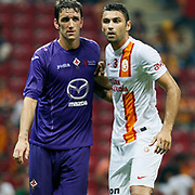 Galatasaray's Burak Yılmaz (R) and ACF Fiorentina's during their friendly soccer match Galatasaray between ACF Fiorentina at the TT Arena in istanbul Turkey on Wednesday 08 August 2012. Photo by TURKPIX