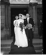18/02/1957<br /> 02/18/1957<br /> 18 February 1957<br /> Wedding Dr K. Murphy and J. Fitzgerald at St. Mary's Church, Haddington Road and reception at Salthill Hotel, Monkstown. Bride and Groom  and Bridesmaid leaving the church after the ceremony.