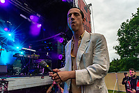 Fat White Family lead singer  Lias leaves the stage and climbs barriers  at the Bigfoot Festival   Ragley Hall Warwickshire one of the first festivals to open successfully in 2021,photo by ark Anton Smith