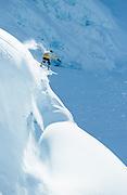 Alaska. Southeast Alaska. Chilkat Range. Jeremy Jones on a sunny winter day, snowboarding.