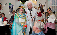 """Cleopatra Nancy Granger earns second prize for her """"cutest"""" pumpkin from Director R. Paul Weston and Program Assistant Tina Goss during the Halloween festivities at the Laconia Senior Center Thursday.  High school students from the Alternative School Jessica Roy, Maggie Hughes, Reggie Pygum, Tim Eichstaedt and Reis Bradford came to judge pumpkin decorating and costumes for the event. (Karen Bobotas/for the Laconia Daily Sun)"""