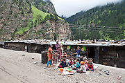 A lesson for the migrant worker children next to a road in the Himalayas, India.  The migrant community is given education and information support by the Pragya organization who have a project helping in high altitude areas across the Himalayas.
