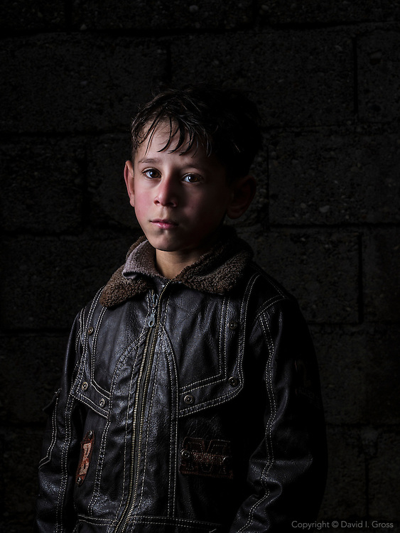 Syrian refugee child at a the Torches of Liberty Syrian school.