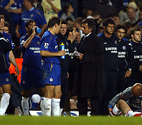 Photo: Chris Ratcliffe.<br />Chelsea v Charlton Athletic. Carling Cup.<br />26/10/2005.<br />Jose Mourinho asks Robben and the rest of his players who wants to take a penalty