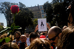 August 18, 2017 - Barcelona, Catalonia, Spain - In the city of Barcelona people pay tribute to the victims of the terrorist attack. A van driver ploughed into pedestrians in Las ramblas street of Barcelona and another in Cambrils seaside city, leaving 13 people dead and injuring more than 100 others. (Credit Image: © Jordi Boixareu via ZUMA Wire)