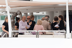 © Licensed to London News Pictures. 13/05/2018. London, UK. Alan Sugar seen with guests on his luxury superyacht, Lady A as it is moored at Butlers Wharf on the River Thames today shortly before Alan Sugar sailed it under Tower Bridge and paraded it in the Upper Pool in central London, before passing under Tower Bridge again and travelling along the river. Alan Sugar reportedly purchased the 181 feet long yacht in 2015 and renamed her Lady A after his wife, Ann and it includes a jacuzzi and can sleep up to 12 guests. Lady A is reportedly still up for sale at around £13m after being put on the market last year, or it can be chartered with prices starting from around £12,500 per week. Photo credit: Vickie Flores/LNP