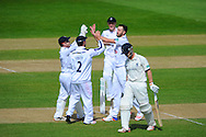 Warwickshire batsman Jonathan Trott walks back to the pavilion after he is dismssed off the bowling of Hampshire's James Vince who ic celebrating taking a wicket during the Specsavers County Champ Div 1 match between Hampshire County Cricket Club and Warwickshire County Cricket Club at the Ageas Bowl, Southampton, United Kingdom on 12 April 2016. Photo by Graham Hunt.