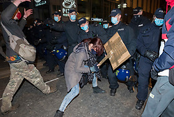 """© Licensed to London News Pictures;03/04/2021; Bristol, UK. A woman pushes against police moving forward and is later arrested at a fifth """"Kill the Bill"""" protest in a fortnight taking place in Bristol against the Police, Crime, Sentencing and Courts Bill during the Covid-19 coronavirus pandemic in England. The Bill proposes new restrictions on protests. Some previous Kill the Bill protests in Bristol had violence. Photo credit: Simon Chapman/LNP."""