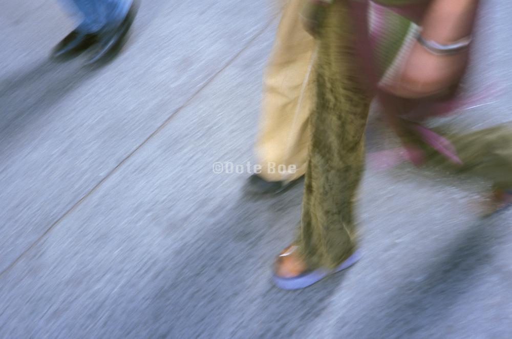 Detail of people walking on an urban street