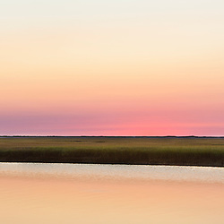 Dawn over the tidal marsh at Fort Hill in the Cape Cod National Seashore in Eastham, Massachusetts.