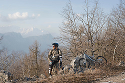 Mid adult man with mountain bike, Italy