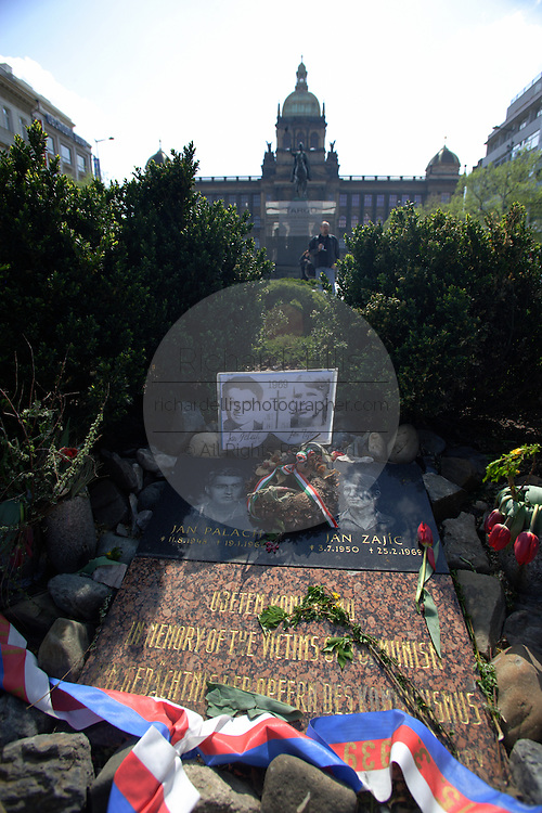 The monument to the victims of communism on the spot where Jan Palach staged his protest in Wencslas Square Prague, Czech Republic. The hotel built in 1903 is one of the most preserved examples of art nouveau architecture in Prague.