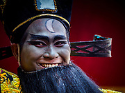 16 FEBRUARY 2018 - BANGKOK, THAILAND: A Chinese opera actor walks down Yaowarat Road during Chinese New Year celebrations in the Chinatown neighborhood of Bangkok. Thailand has a large Chinese community and Lunar New Year is widely celebrated, especially in larger cities. This will be the Year of the Dog.       PHOTO BY JACK KURTZ