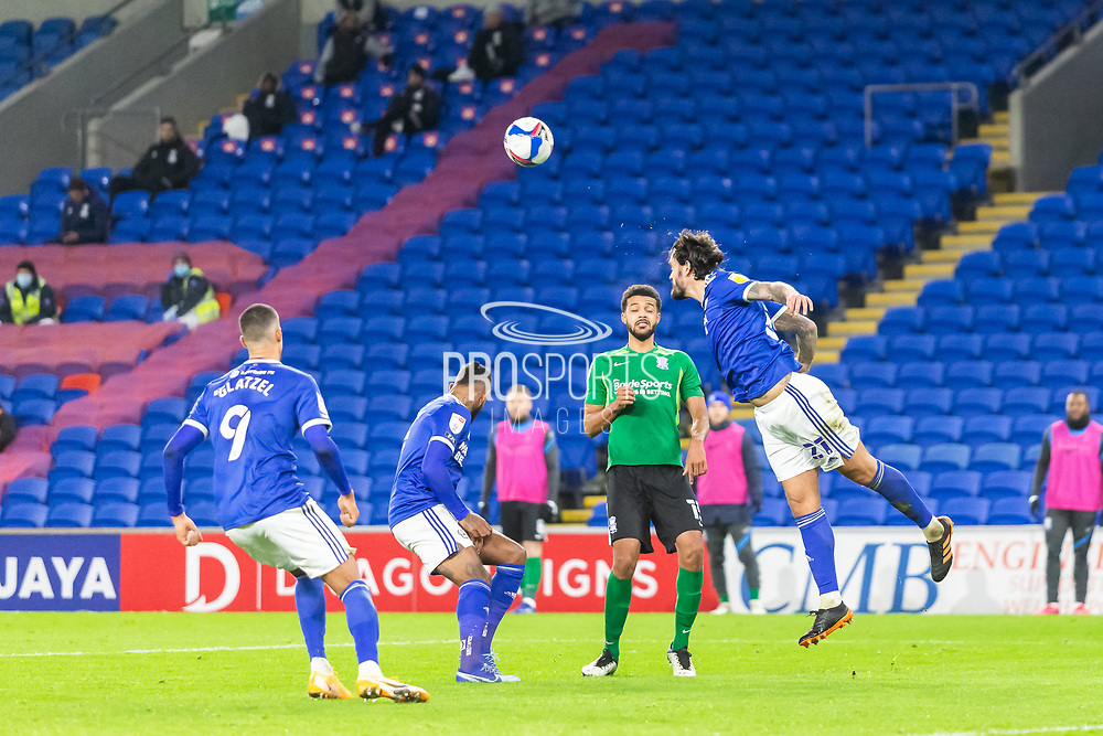 Cardiff City's Marlon Pack (21) heads the ball clear during the EFL Sky Bet Championship match between Cardiff City and Birmingham City at the Cardiff City Stadium, Cardiff, Wales on 16 December 2020.