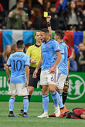 November 11, 2018 - Atlanta, GA, U.S. - ATLANTA, GA Ð NOVEMBER 11:  NYCFC's Alexander Callens (6) reacts after receiving a yellow card from referee Mark Geiger during the MLS Eastern Conference semifinal match between Atlanta United and NYCFC on November 11th, 2018 at Mercedes-Benz Stadium in Atlanta, GA.  Atlanta United FC defeated New York City FC by a score of 3 to 1 to advance in the playoffs.  (Photo by Rich von Biberstein/Icon Sportswire) (Credit Image: © Rich Von Biberstein/Icon SMI via ZUMA Press)