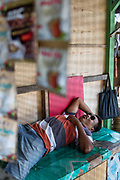 INDONESIA, Central Java, Borobudur Temple, taking a nap at the shops outside the temple.