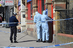 © Licensed to London News Pictures, 05/04/2018, Forensic officers outside Bet Fred betting shop in Upper Clapton Road, Hackney, after a 50 year old male was found on the street with fatal injuries following an altercation with another male. The victim was pronounced dead at the scene; Photo credit: Steve Poston/LNP