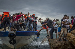 October 11, 2015 - Lesbos Island, Greece - Refugees and Migrants aboard fishing boat driven by smugglers reach the coast of the Greek Island of Lesbos after crossing the Aegean sea from Turkey. (Credit Image: © Antonio Masiello/NurPhoto via ZUMA Press)