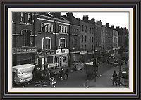 View of brick lane market from junction with bethnal green road finishing up for the day <br />