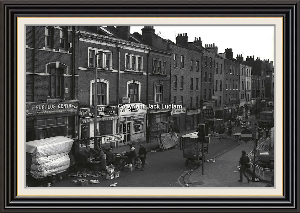 View of brick lane market from junction with bethnal green road finishing up for the day <br /> Series of 7 Black and White Photographes Depicting Brick Lane Market London,  2 feb 1984<br /> A2/A3 Museum-quality Archival signed Framed Print (Limited Edition of 25) From Series of 7 Limited Edition (25) Large Framed Prints A3 Shot on film neg Black and White pictures Depicting Brick Lane Market London, 2 feb 1984 Photographer Jack Ludlam<br /> £1,200